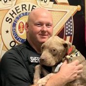 Laurens County Animal Control Sgt. Geoff Brown with Westly after accepting the inaugural Lifesaving Award from No Kill South Carolina.